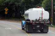 Dozens of Montecitans are trucking in water daily to circumvent rationing measures imposed by the Montecito Water District. The district has the right to shut off water to residents who repeatedly exceed their monthly drought allocations.
