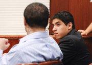 Raymond Daniel Macias, left, looks toward his co-defendant Luis Alfredo Almanza. (June 20, 2014)
