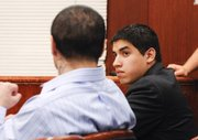 Raymond Daniel Macias, left, looks toward his co-defendant Luis Alfredo Almanza. (June 20, 2014)