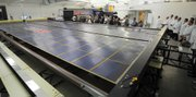 This Roll-Out Solar Array (ROSA) model developed by Deployable Space Systems puts out 25 kilowatts of electric power and may one day support missions to Mars