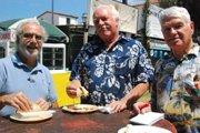 Jeff Waxman and Allan McComb sample carnitas and hot sauce with Barney.