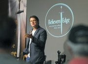 Believer's Edge cofounder John Mullen speaks to the service attendees on a Tuesday morning.