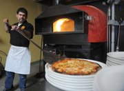 Persona pizzas are quickly baked in an Italian wood-fired oven for 90 seconds