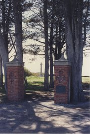 Pillars at the former Campbell estate with the memorial in the background, 1971.