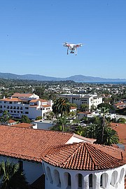 <b>ANYWHERE AND EVERYWHERE:</b>  A Phantom drone hovers over the courthouse as its pilot uses his iPhone to take pictures and video with the on-board camera.
