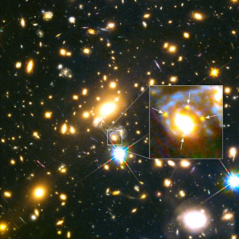 This image shows the lensing galaxy's location within a hefty cluster of galaxies, located more than 5 billion light-years away. In the enlarged inset, the arrows point to the multiple images of the exploding star, dubbed Supernova Refsdal, located 9.3 billion light-years from Earth.