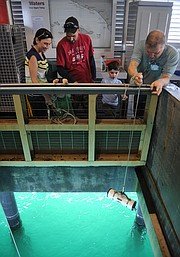 The Harrington family get a seawater sample from under the pier at the Sea Center.