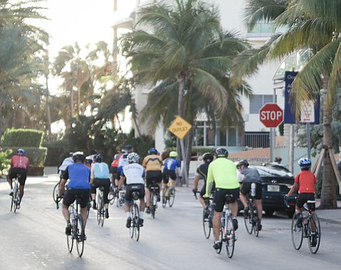 Bicyclists crowding a road