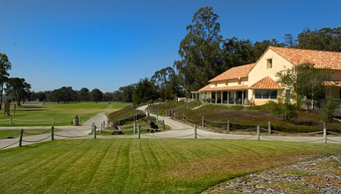 The clubhouse and first tee at Marshallia Ranch