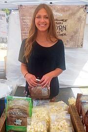 <b>VEGAN VIRTUE:</b> Sierra Swanson served up delicious Santa Barbara Popcorn at Earth Day.