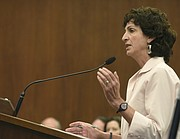 Environmental Defense Center attorney Linda Krop argues for her client Surfrider that the rock revetment be reduced.