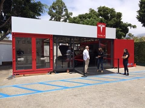 Tesla Motors drops in at the former Greyhound Bus parking lot.