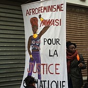 African feminists' banner at Human Chain in Paris November 29, 2015.