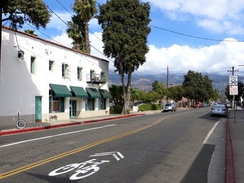 Sharrows won't keep cyclists safe across town on a street like Micheltorena.