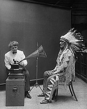 <strong>WORDS PRESERVED:</strong>  Frances Densmore at the Smithsonian Institution records Blackfoot chief Mountain Chief for the Bureau of American Ethnology in 1916.