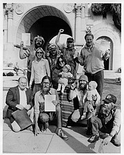 Ed Mannon (upper left) celebrating the legal victory waged by the Legal Defense Center giving homeless people the right to vote even though they lacked a legal domicile.
