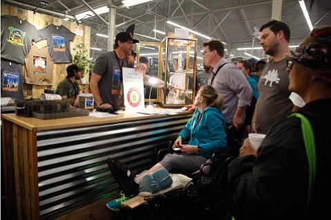 Graham Shaw of Graham's Brand helps a customer at Hempcon 2015. He'll have a booth at Paso Robles's Shatterday event taking place every Saturday in March.
