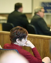 District Attorney Joyce Dudley listens to victim impact statements.