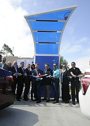 Dignitaries cut the ribbon Friday at the Central Coast's first electric-car charging station, located at La Cumbre's Conserv Fuel.