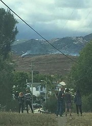 El Encanto Heights neighbors spy smoke from a half-acre grass fire that broke out Tuesday evening behind Glen Annie Golf Club.