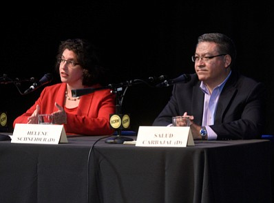 Helen Schneider has accused opponent Salud Carbajal in the 24th Congressional District race — both seen here at a forum in May — of sending out a misleading and hypocritical mailer.