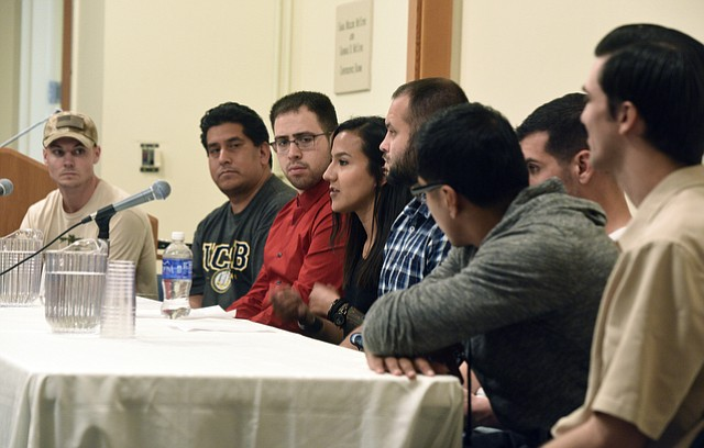 Members of UCSB's Veterans Writing Workshop (left to right) Derek Downey, Edgar Guapo, Alvin Arceo, Rocio Iribe, Yevgeniy Levin, Max Peck, Martin Carranza, and Dereck Sutherland answer questions from the audience following the reading of their stories.