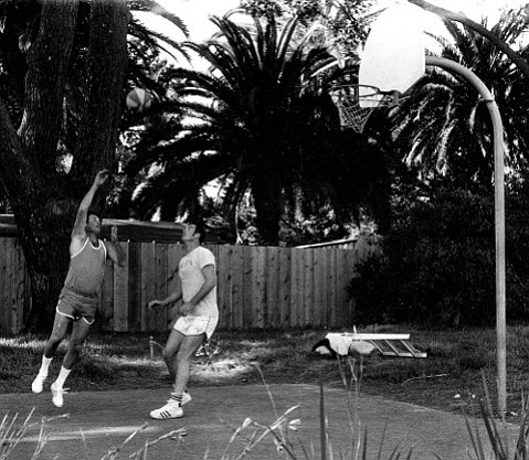 Larry Crandell (left) plays one-on-one against Marv Branch at the Crandell's backyard basketball court.