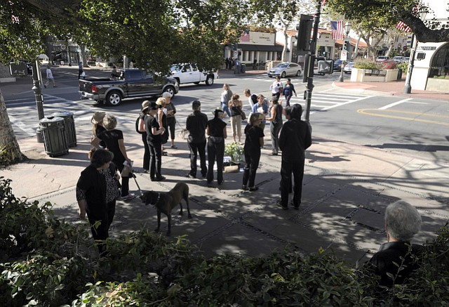 A dozen members of Santa Barbara in Black gather at the corner of State and Anapumu streets, vowing to stay vigilant for Donald Trump's actions as president.