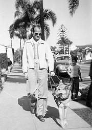 Jim Branigan (pictured below with guide dog Rex).