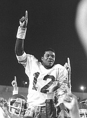 <b>ALWAYS A DON:</b> Randall Cunningham was hoisted by his Santa Barbara Don teammates after his heroics in the final minute lifted them to a 15-14 victory over Dos Pueblos in 1980.