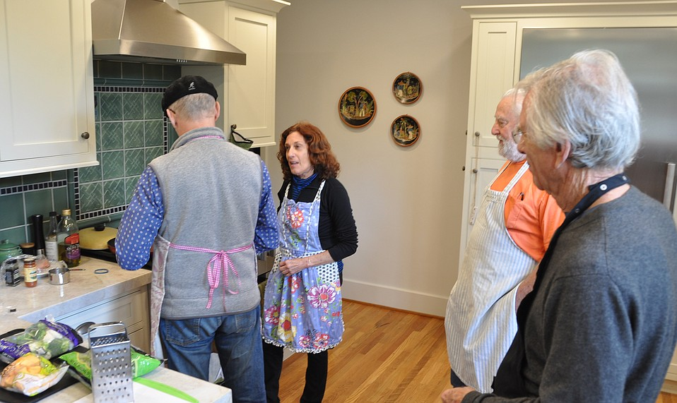 A bakery owner turned cooking teacher, Laurie Zalk breaks down the mystery of perfectly prepared chicken and rice with veggies to one of her students at a recent Men Only class, just one of the at-home culinary courses she offers.