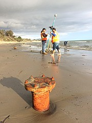 A survey team led by the State Lands Commission inspects Summerland Beach, where recent storms have uncovered historic oil wellheads.