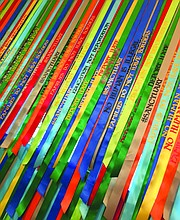 """Political Ribbons"" (2016) by artist Andrea Bowers now hang against a large window in the Westmont Ridley-Tree Museum of Art."