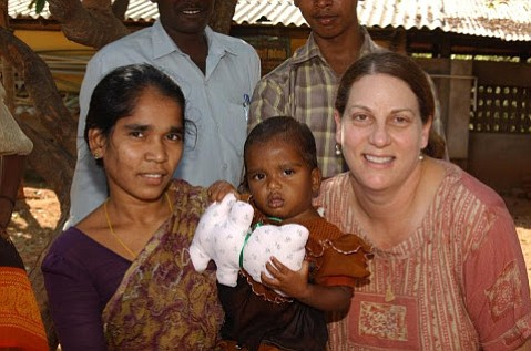 Sue Fowler, right, meets with a mother and child in Tamil Nadu, India, in 2006. Access to health care and basic human rights are still a work in progress for women in many countries.