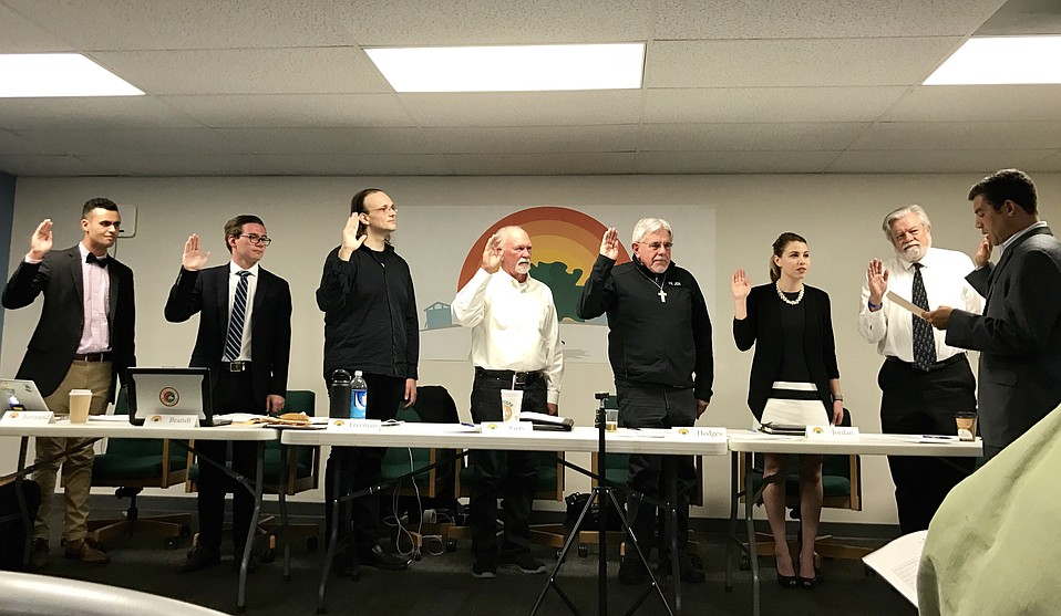 The first board of Isla Vista's Community Services District — Ethan Bertrand (left), Spencer Brandt, Jay Freeman, Bob Geis, Father Jon Hedges, Natalie Jordan, and George Thurlow — is sworn in by 1st District Supervisor Das Williams, who shepherded the enacting legislation while assemblymember.