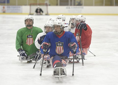 The team's scores are recorded on a Nerf football. Next up is the World Championship in South Korea. Rico Roman (center) of the USA National Sled Hockey team practicing at Ice in Paradise