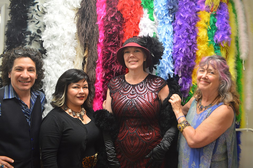 Happy customer Christine Cortes wears a one-of-a-kind costume with a headpiece custom-made for Victorian Vogue & The Costume Shoppe.