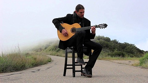 Chris Fossek, seen here along East Camino Cielo, puts his own Santa Barbaran stamp on Spanish guitar stylings.