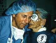 A patient whispers to Dr. Harry S. Brown in SEE's earlier days.