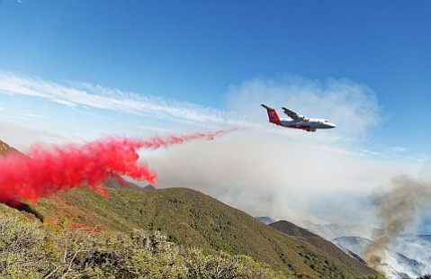 The Sherpa Fire — fought with aircraft and fire crews costing over $16 million — started when a smoking fireplace log was taken outdoors and its embers dropped into windblown grasses.