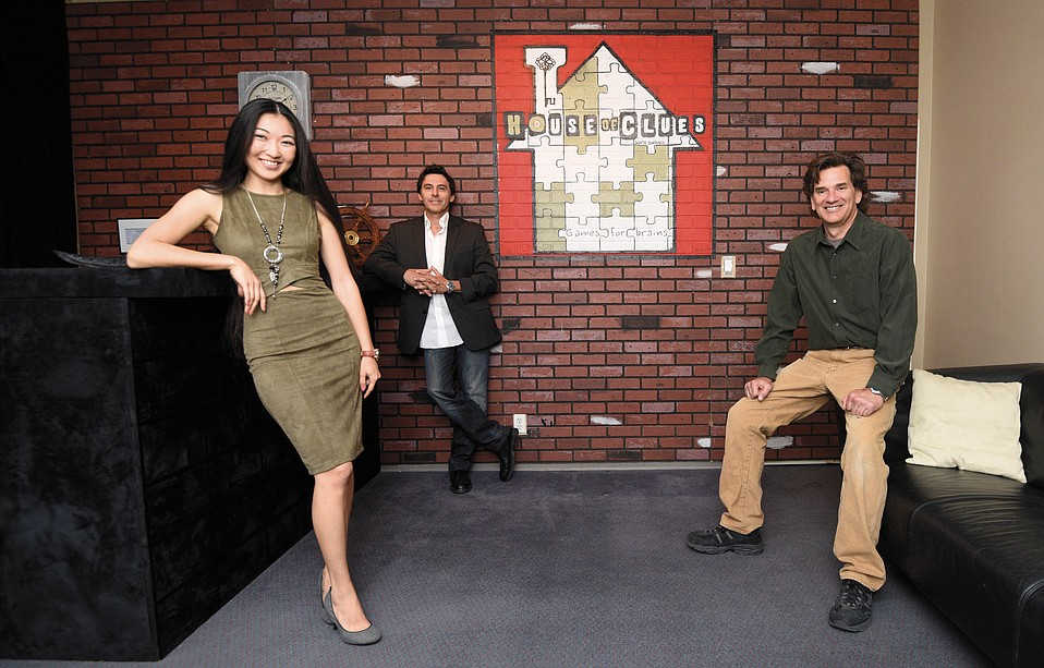 The House of Clues Santa Barbara's co-owners (left to right) Assel Abdrakhmanova, Oscar Zevalos, and Whitman Heining stand in their new escape room.