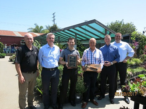 Gary Simpson (third from right) holds the golden hammer awarded to his Home Improvement Center for volume in 2016. To his right are Ace honchos John Venhuizen (president) and Brian Wiborg (VP), and to his left are Michael Owens, ops manager for Home Improvement, and Ace's Charlie Kukla (district manager) and Bill Hurley (regional manager).