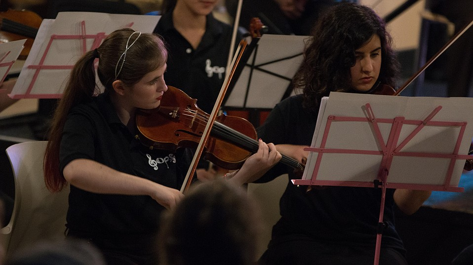 UCSB's Pops Orchestra is made up of non-music majors, including Sara Bashore (left) and Kamila Hoenk.