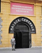 Graham stands before Hoa Lo Prison, better known as the Hanoi Hilton, which housed POW Lt. Commander John McCain for five torturous years.