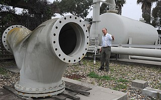 Robert Roebuck, a project manager with the city's Public Works Department, leads a tour of the dormant desal plant in February 2014.