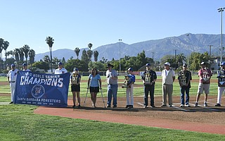 Mayor Helene Schneider welcomed Bill Pintard and his Santa Barbara Foresters to their new home at Pershing Park. The club has brought six National Baseball Congress World Series trophies to the city. Players stood for the anthem before the home opener. John Jensen (13) got the first hit and scored the first run in a 7-4 win over the Orange County Riptide. A young fan's souvenir jersey needs some straightening out.