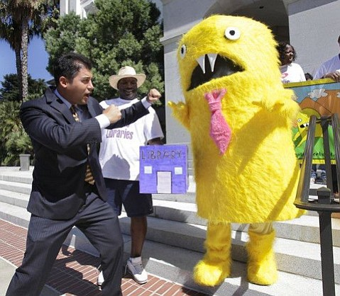"Das Williams dukes it out with the ""privatization beast,"" which he fought as an assemblymember in 2011 when taking California's public libraries private was proposed."