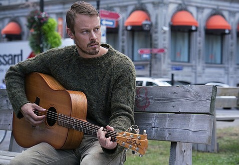 Amazon's Patriot stars Michael Dorman as a folk singer/intelligence officer who goes undercover as an employee at a Midwestern industrial piping firm.