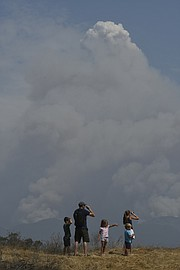 The Hoffmann family watch the Whittier Fire from Cathedral Oaks Sunday, July 9, 2017.