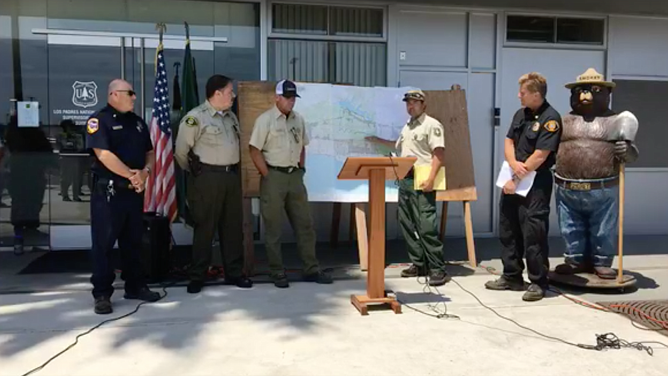 U.S. Forest Service, CAL FIRE, County Sheriff and Fire officials gather at the Los Padres National Forest Headquarters for a press conference on Sunday afternoon.